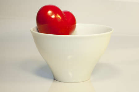 waxes: A heart looks out from a white bowl