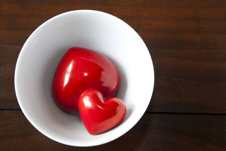waxes: Two red hearts are in a bowl Stock Photo