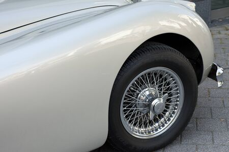well maintained: Well maintained front wheels with a vintage car
