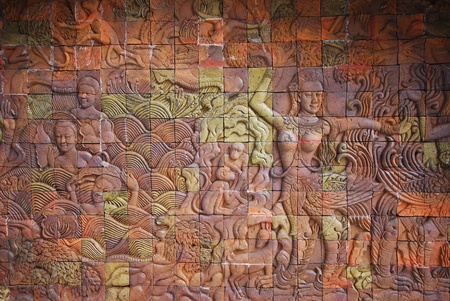 Traditional Thai baked clay art on the wall Stock Photo