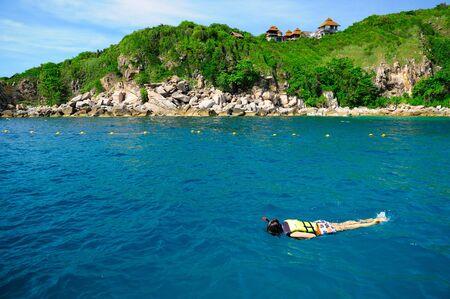 woman free diving snorkeling in beautiful blue ocean Stock Photo