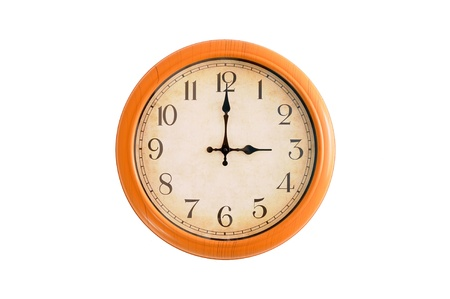 Clock showing 3 o clock pm on a white wall Stock Photo