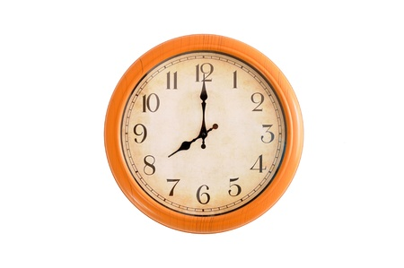 pm: Clock showing 8 o clock pm on a white wall