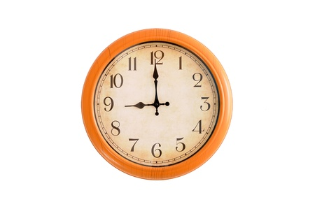 Clock showing 9 o clock pm on a white wall Stock Photo