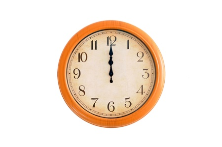 Clock showing 12 o clock on a white wall Stock Photo