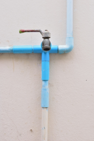Water tap and PVC pipe photo