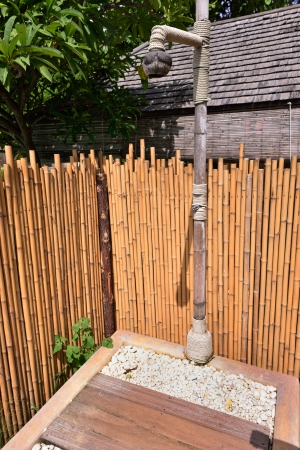 Outdoor shower is surrounded with bamboos Stock Photo