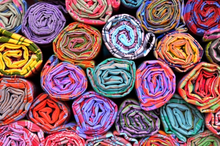 Colorful fabric rolls  Focus on front of rolls