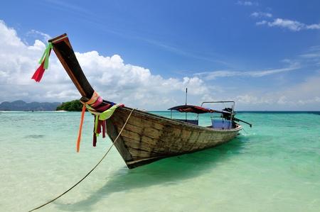 Boat on beautiful beach at Phi Phi island, Krabi, Thailand photo