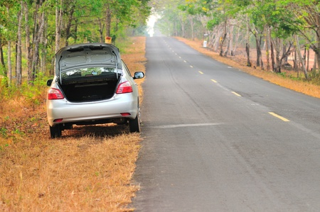 broken-down car on an asphalt road