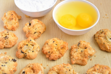 Cereal cookies on a wooden panel with ingredients Stock Photo