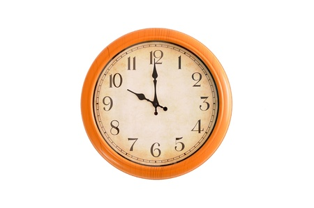 Clock showing 10 o clock on a white wall