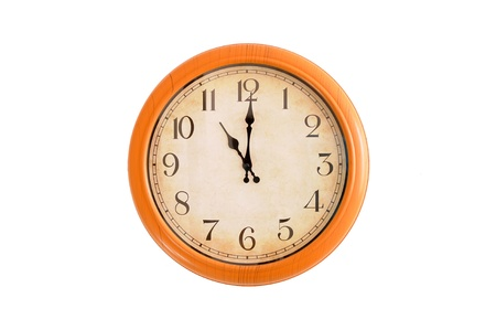 Clock showing 11 o clock on a white wall