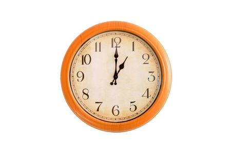 Clock showing 1 o clock on a white wall