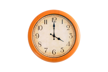 Clock showing 4 O clock on a white wall