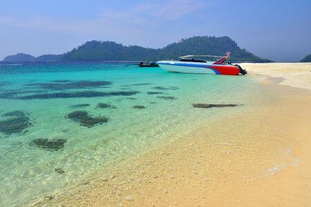 Boat parks on a beautiful beach at Lipe island