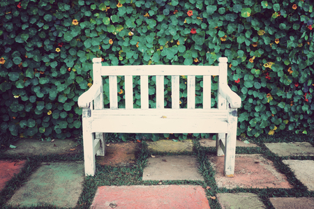Vintage white bench and flower background