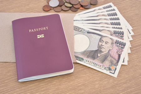 Japanese banknotes with passport Stock Photo