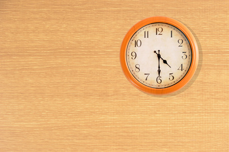 o'clock: Clock showing 4:30 oclock on a wooden wall