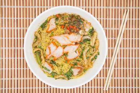 people eating restaurant: Egg noodle soup with red roast pork, top view Stock Photo