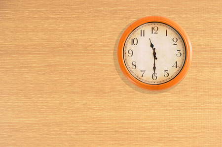 o'clock: Clock showing 11:30 oclock on a wooden wall