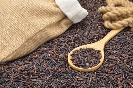 black rice: Organic brown rice, focus on wooden spoon