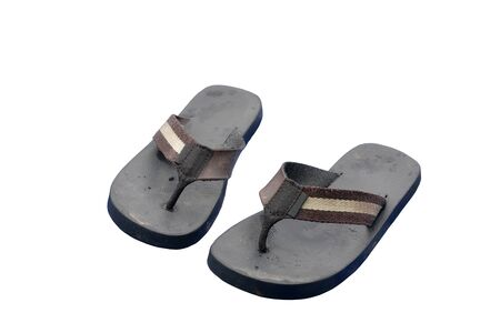 sandles: Pair of dirty black retro rubber sandals isolated on a pure white background