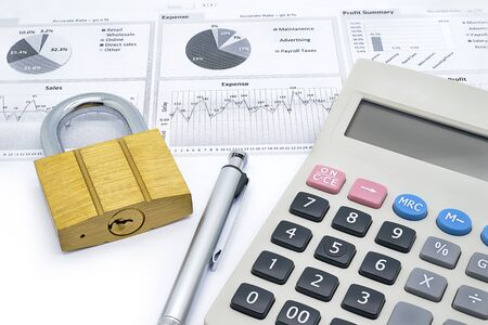 put the key: calculator, pen and master key put on financial dashboard isolated on white background