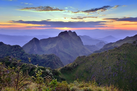 Cliff view of beautiful sunset and sky with sea of mist at Doi Luang Chiang Dao National Park, Thailand