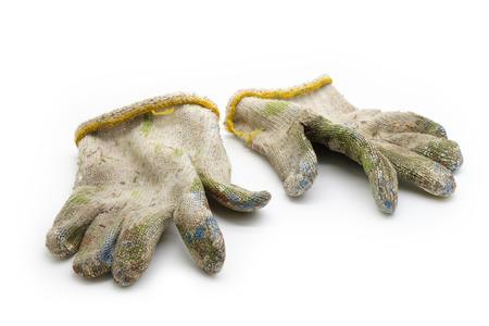 dirty worn cloth gloves Stock Photo