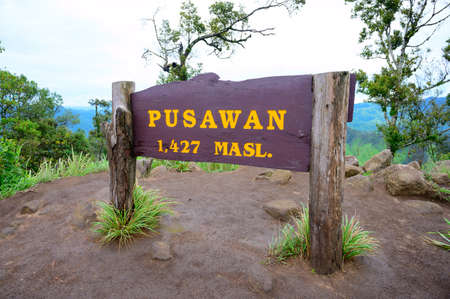 Pusawan signpost on the top of Pusawan mountain at Maewong National Park, Kamphaengphet province, Thailand