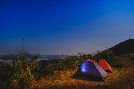 Khao Chang Phueak Mountain at night time with camping tents