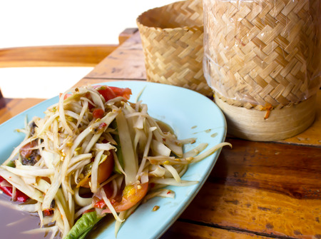 minutiae: som tam thai, green papaya salad, sticky rice in bamboo