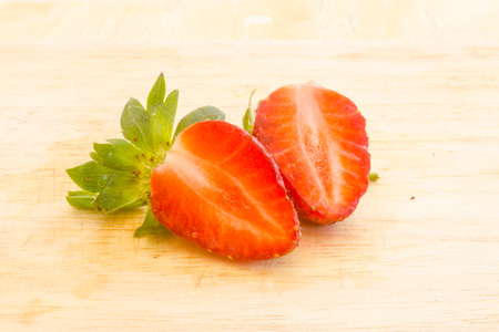 strawberry sliced on wood background.