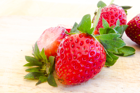 strawberry sliced on wood background.