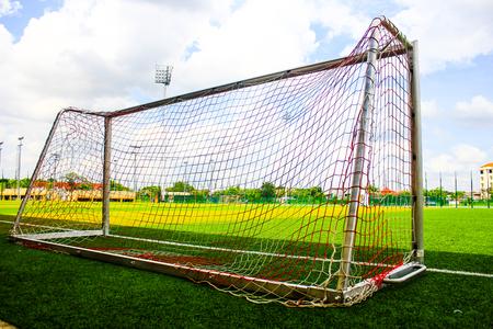 Soccer goal on green grass Imagens