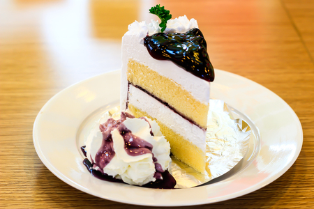 cold cut: cheese cake with blue berry on top Stock Photo