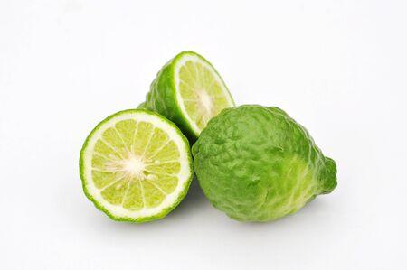 Three leech lime fruits isolated on white Zdjęcie Seryjne