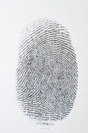 Black fingerprint on white paper photo