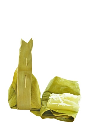 Sticky rice wrapped in banana leaf photo