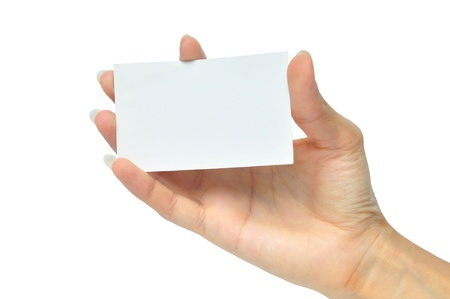 business card in hand: Close-up of an empty business card in a womans hand isolated on white Stock Photo