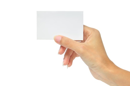 Close-up of an empty business card in a woman's hand isolated on white photo