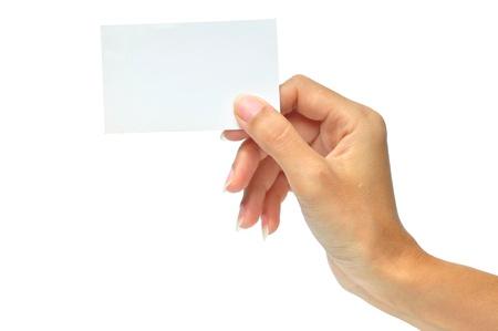 Gros plan d'une carte de visite vide dans la main d'une femme isolée sur fond blanc. Banque d'images