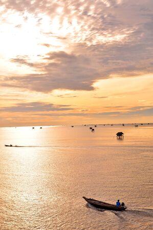 Fishing boat and Sunrise on Thailand Stock Photo - 15046857