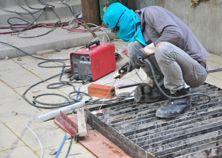 welder in construction site photo