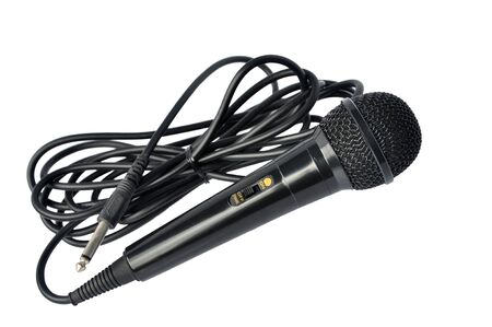 dynamic mic with a curled cable over white.  photo