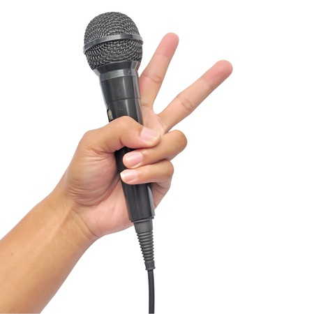 Hand holding microphone on white Stock Photo - 15299243