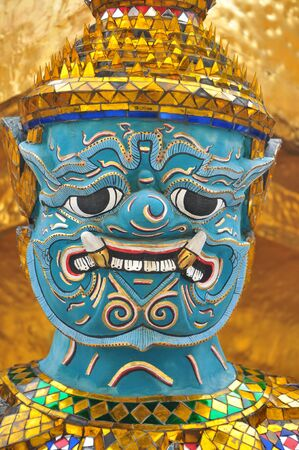 Closeup od giant stands in the temple of the emerald buddha, Bangkok Thailand  photo