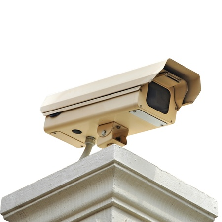 under surveillance: Security camera on the post with outdoor housing  Stock Photo