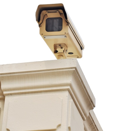 bullet camera: Security camera on the post with outdoor housing  Stock Photo